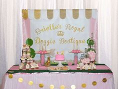 Pink and gold dessert table at a doggie boutique birthday party! See more party ideas at CatchMyParty.com!