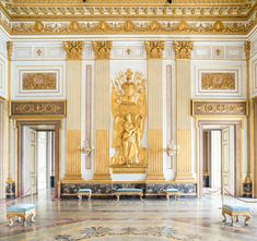 Royal Palace of Caserta, Italy.  The Throne Room.  Perfect neoclassical decoration.  the theme is gold and white.  Note the use of gilded Corinthian pilasters, friezes with 46 medallions depicting the former King of Naples.