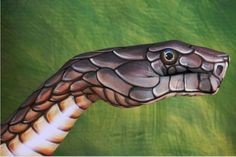 snake painted on a hand by Guido Daniele