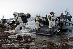 Members of Zulu Company, 45 Commando Royal Marines during an amphibious landing from various landing craft as part of their winter deployment to Norway.