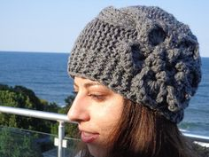 Grey cable knit hat with flower