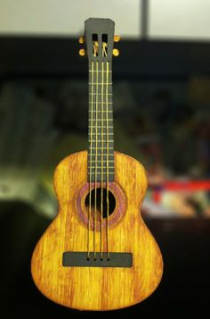 Gorgeous!  This beautiful Guitar is from VINTAGE VALENTINES SVG KIT.  Deb made this one to look realistic and WOW, she did it!  This is her ukulele for her husband who actually makes real ukuleles!  I bet he was so surprised when he saw this!