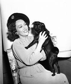 Gloria Swanson and her cute dog!