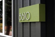 Modern house numbers and a pop of color makes them stand out. also like the dark gray house paint with the lime green.