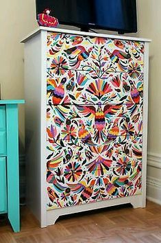 Fancied up chest of drawers. Very colorful!