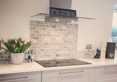 A kitchen splashback is a great way to create a focal point in your living space, just like has done with the beautiful Italiana Gris Brick Mosaic, a stunning travertine tile, enhanced by its soft greys, charcoals and creams creating the u Open Plan Kitchen, New Kitchen, Kitchen Decor, Kitchen Ideas, Kitchen Splashback Tiles, Kitchen Cabinets, Splashback Ideas, Brick Tiles Kitchen, Metro Tiles Kitchen