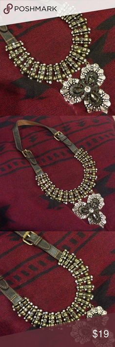 Statement Necklace Unique Statement Necklace with faux brown leather buckled strap. Adorned with antique gold plated beads and clear & smokey rhinestones. No missing stones. Only worn one time and got tons of compliments!! Jewelry Necklaces