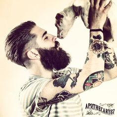 Chris John Millington and a puppy - full thick dark beard and mustache beards bearded man mens' style tattoos tattooed hairstyle hair undercut dogs dog handsome apothecary87 model #mansbestfriend #goodhair #beardsforever