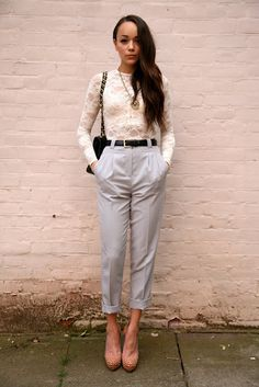 Ashley Madekwe.  High-Waisted Pants + Cropped + Fitted Lace Top + Belt