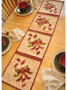 "Celebrate the Christmas season with this beautiful table runner!   Your kitchen decor will be complete once you deck it out with this vintage-inspired runner that features sweet candy canes wrapped in a tidy bow. You can even use each individual square to make matching place mats! Finished size is approximately 12 1/2"" x 53""."