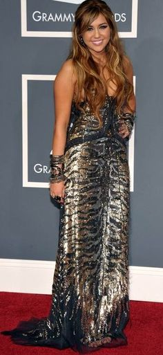 Miley Cyrus in a metallic animal print gown