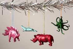 GLITTER ORNAMENTS  I love the idea of turning plastic animals into Christmas ornaments – you could make an entire themed tree!
