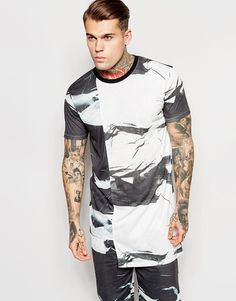 Imagen 1 de Camiseta extralarga con bajo escalonado y estampado de cemento de ASOS
