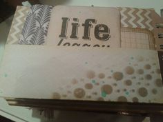A page for journalling - tags from project life. Shadow stencilling? And aqua ink splatters for added colour.