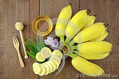 Thai beauty and anti-aging dessert recipe. Cultivated Banana (Musa sapientum Linn.) with honey on Natural Wood Background.