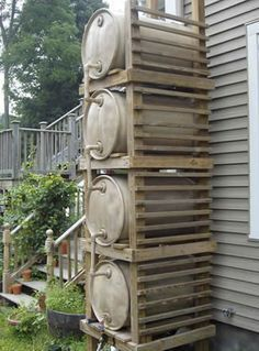 """Rain barrel """"tower"""" for added capacity and pressure. I need to figure out some rain barrel system to store water for the horses so I don't have to lug so much. I've got three nice steel barrels, just need to figure out how to hook them up."""