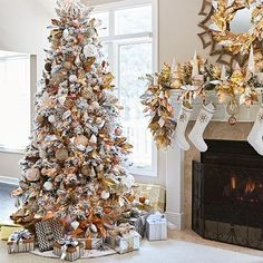 Artificial flocked tree with metallic copper, silver, gold and pink mercury glass ornaments.