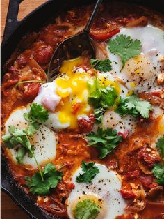 Classic Shakshuka - baked eggs in a spicy tomato-based sauce. A one pot meal that's perfect for breakfast, lunch, or dinner.