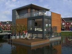 Floating homes in Den Bosch by Alexander Henny
