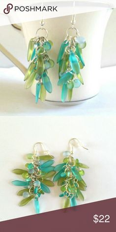 Beautiful frosted glass cluster earrings These light and airy earrings are made with frosted  glass dagger and donut beads in shades of aqua / turquoise and green   I use professional quality jewelry supplies in all of my designs. Any earring can be converted to clip-on Jewelry Earrings