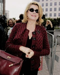Catherine Deneuve arrives At Louis Vuitton Spring Summer 2005 Ready To Wear Fashion Show In Paris. On October 10, 2004 In Paris, France