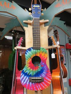 Fan Favorite! Description Colorful, fun soprano ukulele that is extremely playable and well made. The injection molded body and agathis wood top make this both durable and acoustic. We like 'em and we