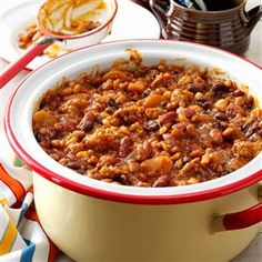 Smoky Baked Beans Recipe -They'll be standing in line for this saucy bean recipe, full of campfire flavor. A variation on colorful calico beans, it makes a great side dish with all your cookout favorites. —Lynne German, Cumming, Georgia