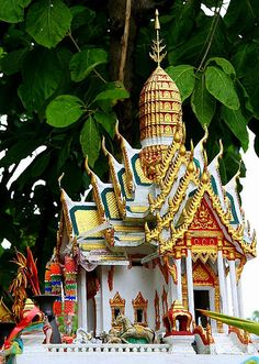 Spirit House--when a new house or building is built in thailand, special 'spirit houses' are built to accommodate the spirits that have been displaced from the land by the construction. As a general rule, the spirit houses should match the grandeur of the house or building that is built.  Bangkok, Thailand