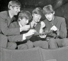 Now this photo is just too funny, the Beatles snacking on wiener links! Bet this was somewhere in the US, only the finest grub for our foreign visitors! Ha!