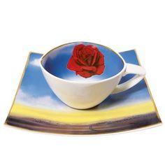 Na filiżance do kawy z motywem z twórczości Salvadore Dali także znajdziemy czerwony kwiat róży. #Goebel