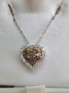 14 Kt white gold heart shaped white and espresso diamonds at The Golden Butterfly Jewelers.