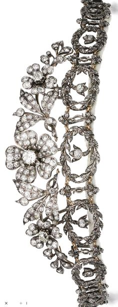 Diamond tiara, late 19th century composite Of floral and garland motif, set with cushion-shaped and rose diamonds, the three central flowers can be detached and worn as brooches, accompanied by three brooch fittings. Image Sotheby's