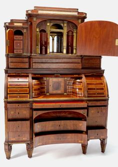 A NORTH GERMAN EMPIRE MAHOGANY TEMPLE-FORM TRIPLE ROLL-TOP DESK .Maker unknown, Germany