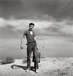 """Seventeen year old boy going to feed the pigs. Homedale district, Malheur County, Oregon.""""1940s"""