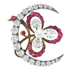 Antique Diamond, Ruby and Pearl Brooch   Silver, gold, the crescent set with 19 old-mine cut diamonds approximately 2.25 cts., centering a three-leaf clover edged by 23 round rubies, centering one button pearl approximately 5.5 mm., and 3 old-mine cut diamonds approximately 1.05 cts., approximately 8.7 dwt. Victorian or Victorian style.
