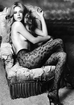 Doutzen Kroes - love this for a simple boudoir shoot. Intricate, detailed tights, hint of side boob, very tasteful and pops in black and white.