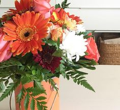 Perfect peach roses, orange gerbera daisies & orange spray roses with a pop of white chrysanthemums
