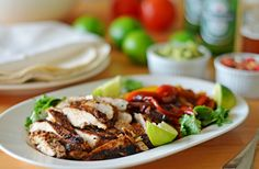TESTED & PERFECTED RECIPE - These chicken fajitas – with smoky, charred chicken and caramelized onions and peppers – are delicious and easy to prepare.