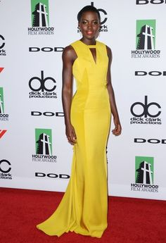 Lupita Nyong'o // yellow gown + red lip