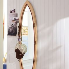 love the mirror! & we can fill the room with Alex's surfing pictures and our beach photos! Oh I'm so excited to decorate