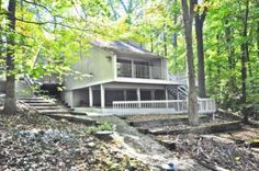 Absolutely stunning secluded Contemporary lakefront home on Sweetwater Lake located on 1+wooded acre in quiet cove. Completely renovated 2006. Galley Kitchen with stainless steel appliances, Pantry. Breakfast Room with slider out to Deck overlooks magnificent Great Room with wood burning fireplace, cathedral ceilings. two ceiling fans, great views of color full famous Brown County year round. Three Bedrooms with daylight windows, three Baths. Family Room in Basement with Laundry Area. Decks…