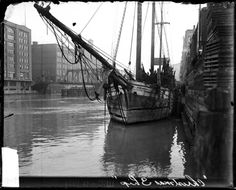 The schooner Arendal is seen here docked at Clark Street to deliver Christmas trees from Michigan. #chicago #history #winterinchicago