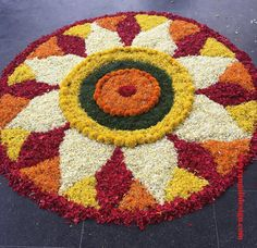 50 Most Beautiful Flower Rangoli Designs (ideas) that you can make during any occasion on the living room or courtyard floors. Easy Rangoli Designs Videos, Easy Rangoli Designs Diwali, Simple Rangoli Designs Images, Rangoli Designs Flower, Free Hand Rangoli Design, Rangoli Border Designs, Rangoli Patterns, Colorful Rangoli Designs, Rangoli Ideas
