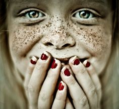 This photo is priceless!  Girl with freckles and chipped nail polish.