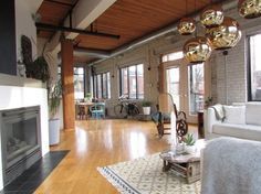contemporary living room by Jenn Hannotte / Hannotte Interiors Turned a factory floor into a loft...