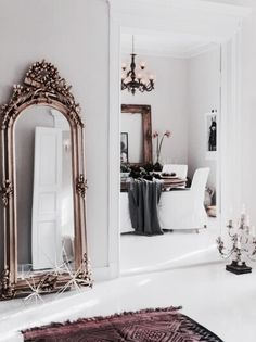 That oversized, giant and ornate mirror makes an excellent interior decor statement. Love!