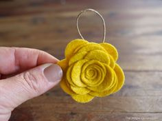 Incl tip on how to use freezer paper to easily cut felt. DIY Felt Flower Ornament Tutorial : www.theMagicOnions.com