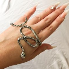 Our Snake Hand Wrap is a unique, exotic hand accessory. Let your hand do the talking with sexiness and a bit of danger that only a serpent can bring. Adjustable - bend to fit your hand Snake Bracelet, Snake Jewelry, Hand Bracelet, Cuff Jewelry, Hand Jewelry, Snake Ring, Fantasy Jewelry, Gothic Jewelry, Full Finger Rings