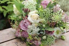Scented summer bouquet of roses, sweet peas, nigella, astrantia, herbs including home grown flowers for the soft, natural, country style.
