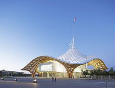 The undulating fiberglass roof of the Centre Pompidou-Metz in Metz, France, forms a large hexagon over the galleries and restaurant within. The museum, whose interior framework resembles the intricate weave of a Chinese hat, has been one of the area's most popular tourist attractions since it opened in 2010.